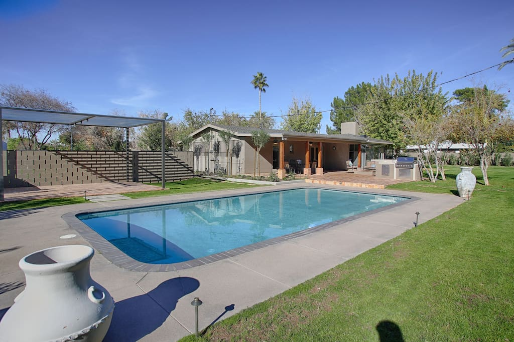 Enjoy a one-of-a-kind 1940s-inspired rare classic home, complete with an entertainment patio with a gated pool, BBQ, fireplace, and dining table