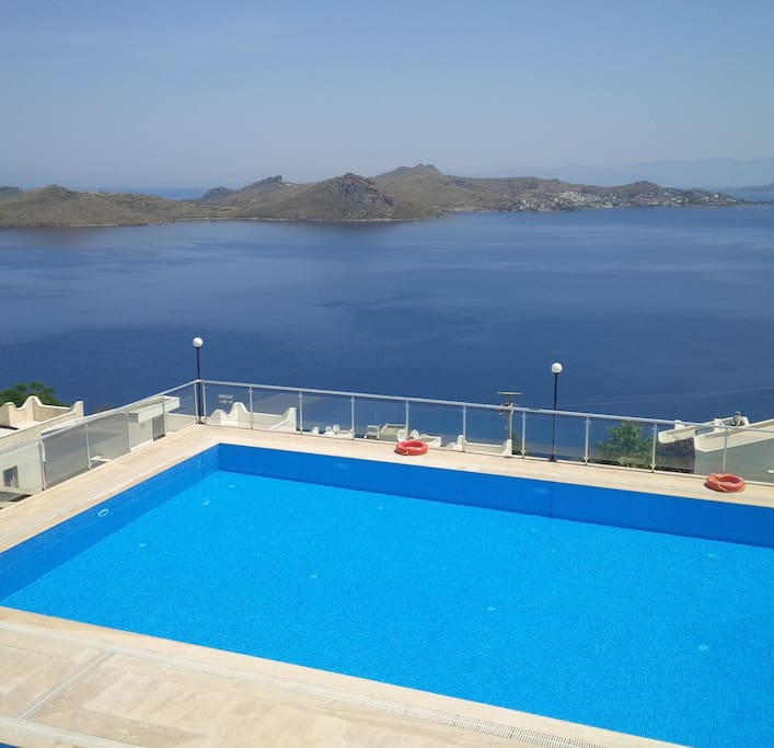 Swim with a view - refreshing dip on a hot day in an panoramic swimming pool