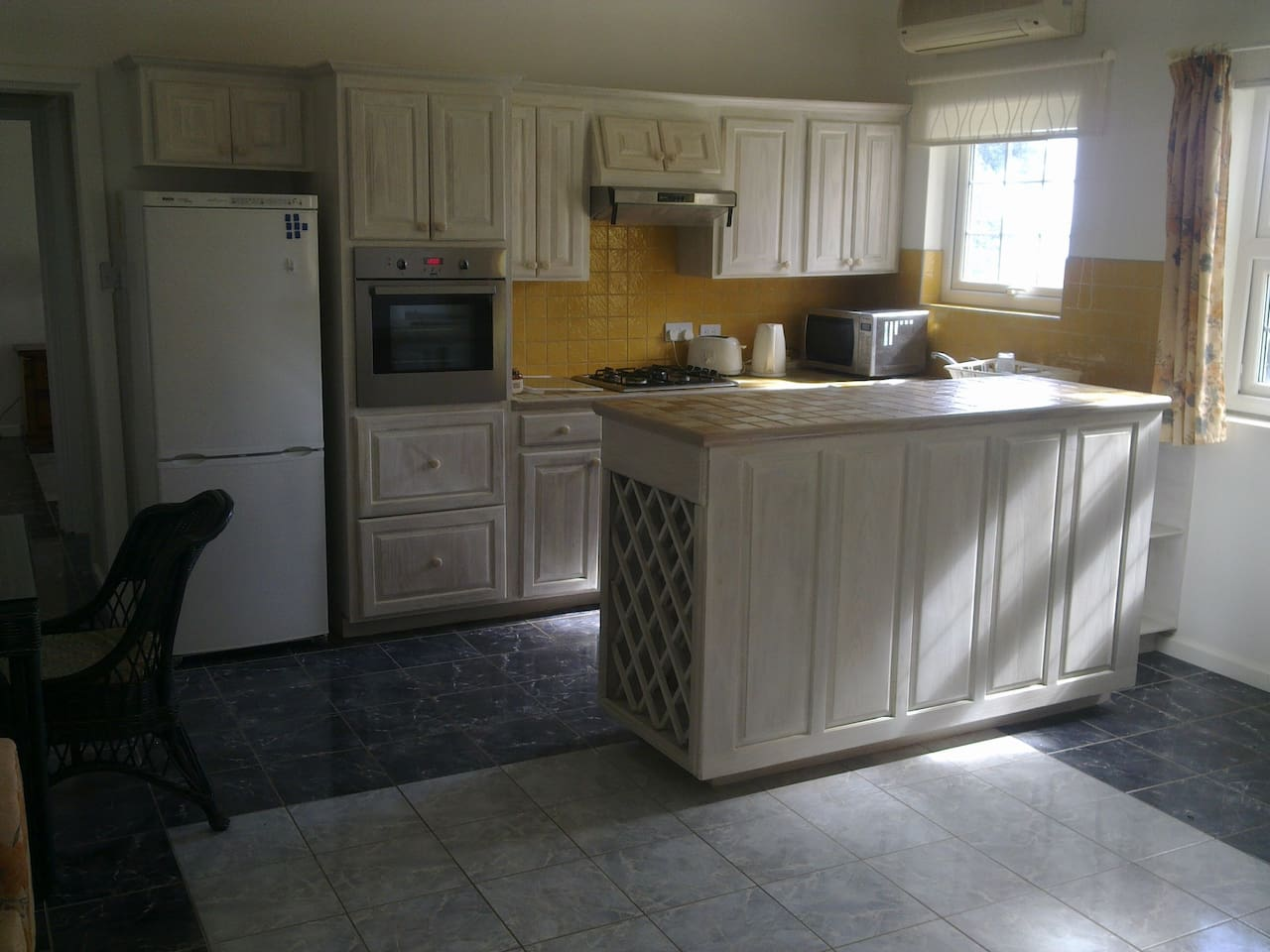 Well equipped kitchen with fridge-freezer and split level cooker.