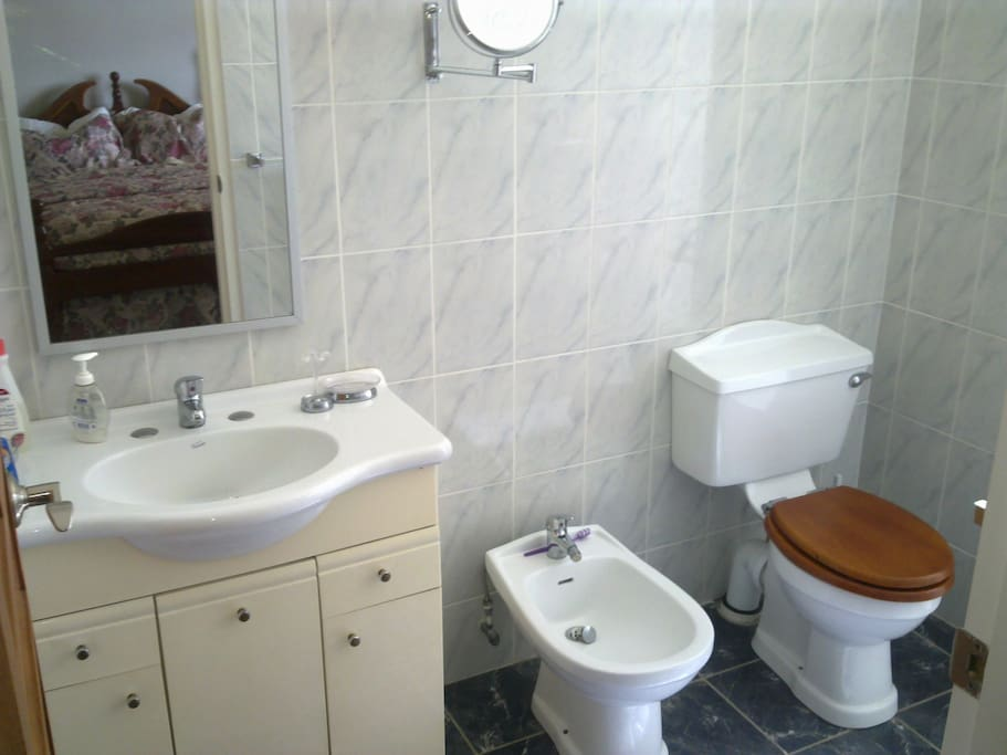 Both bathrooms include shower and bidet.