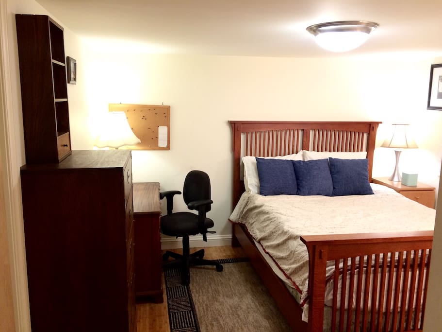 The room has everything you would require: a comfortable queen-sized bed, desk, and plenty of storage.