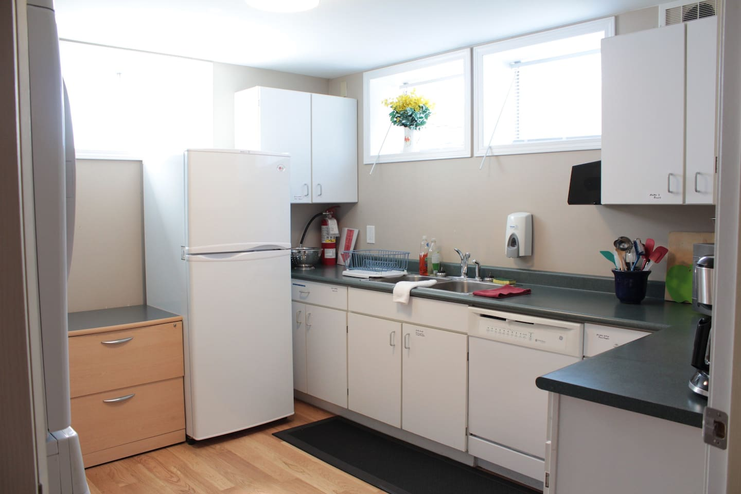 Full kitchen with fridge, stove, washer and dryer