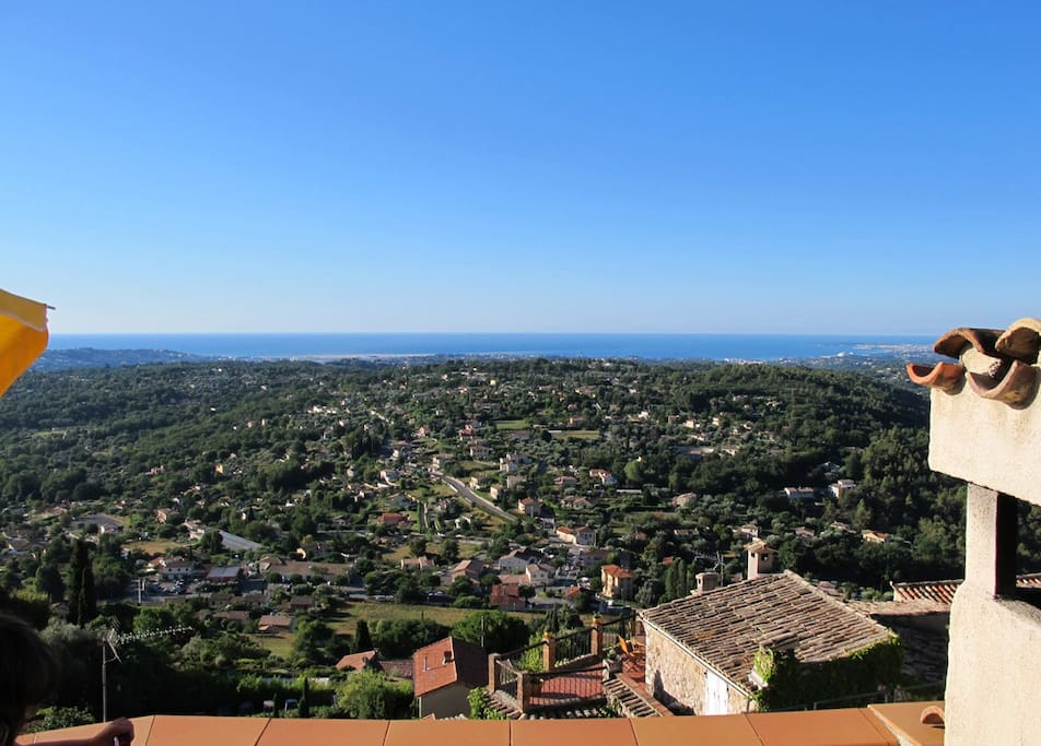 the view from the roof terrace with Antibes to the right and Nice to the left