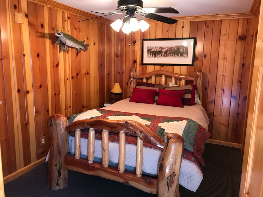 Master bedroom with reclaimed wood walls