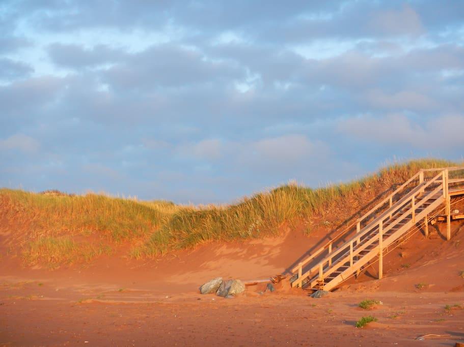 Sneak through the dunes and enjoy miles of beach.