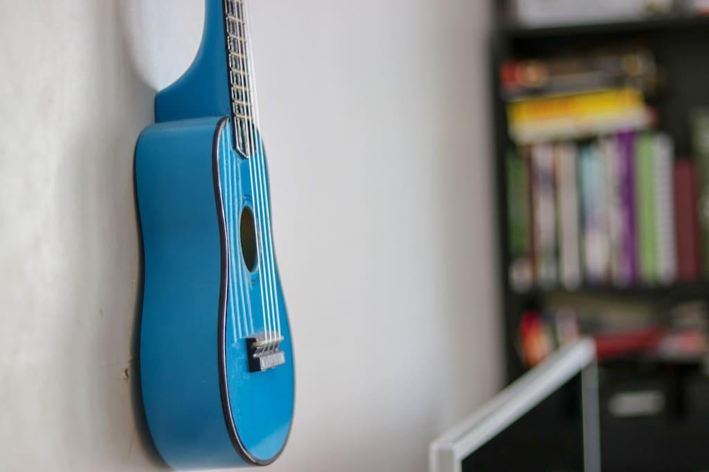 A decorative blue Ukulele