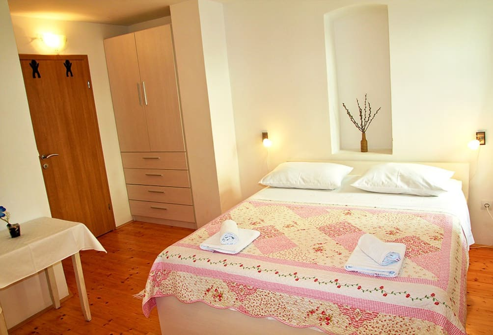 Bedroom on first floor with comfortable bed for two, additional bed and private bathroom