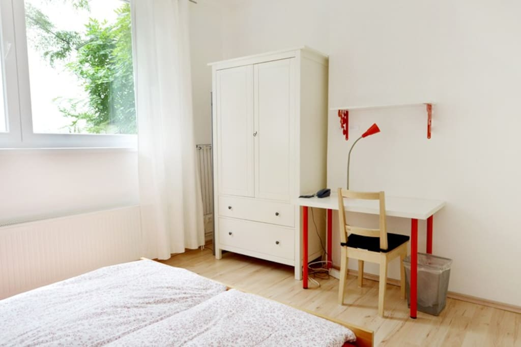 More of the bedroom space with wardrobe and Office desk with Free WiFi