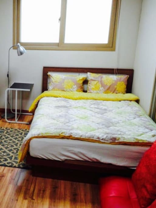 Double sized bed with cozy and warm beddings