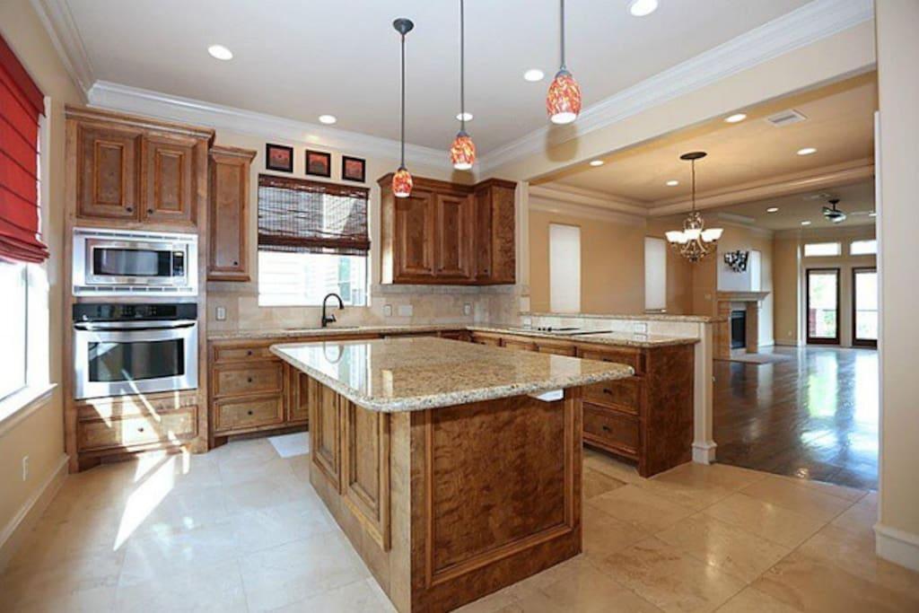 Huge granite Kitchen with breakfast bar.