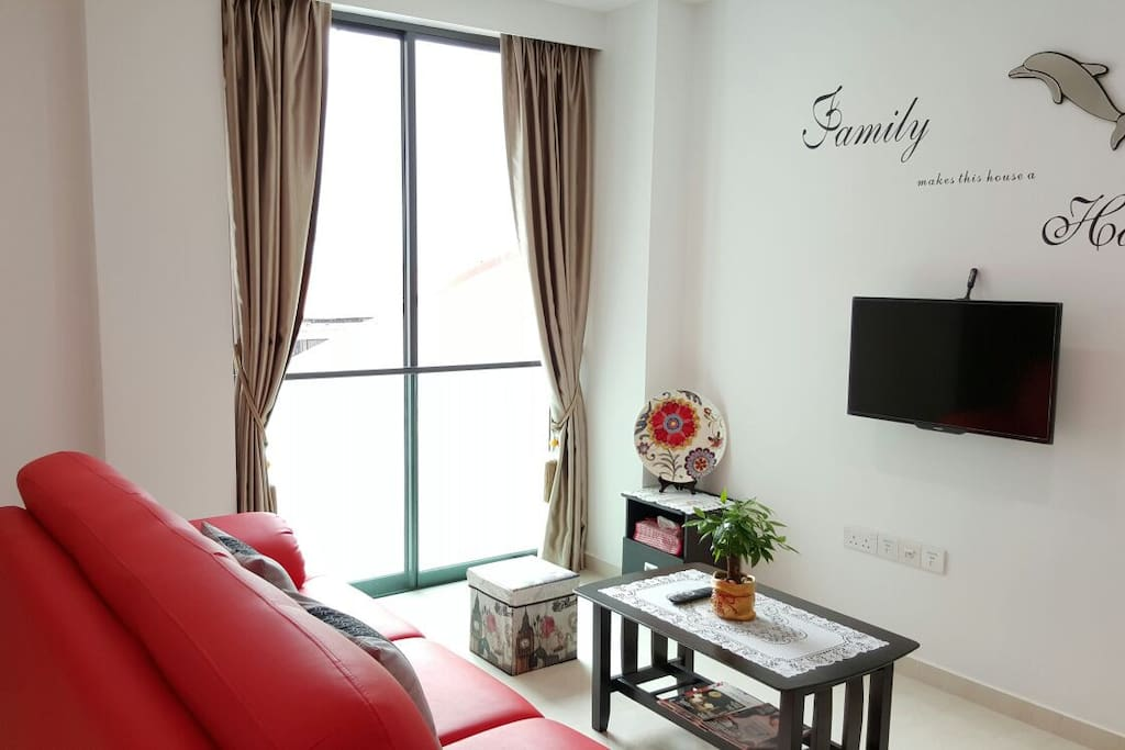 The living room is decorated with 'FAMILY' theme in mind.