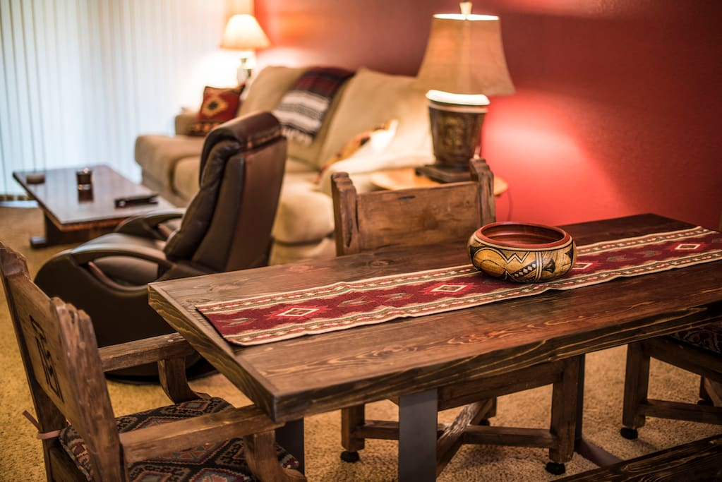 Brand new custom made dining room table with antique chairs that came from Thunder Mountain Ranch. One of the first ranches in Sedona.