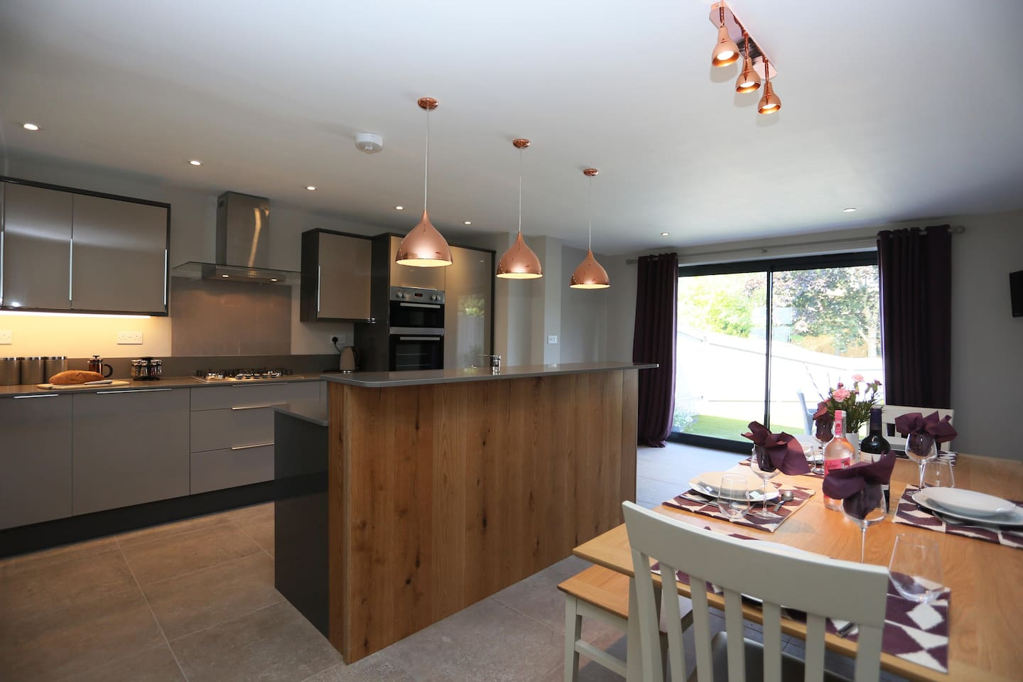Well-equipped kitchen with integrated oven and gas hob, fridge/freezer, dishwasher, microwave, washing machine/tumble dryer,  iron and ironing board.  Open plan living area leads to secure rear garden.