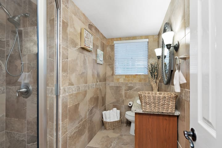 Apartment Bathroom with Tile Shower