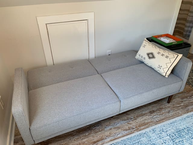 The sofa folds out into a small bed.  We can provide additional linens and pillows if needed.