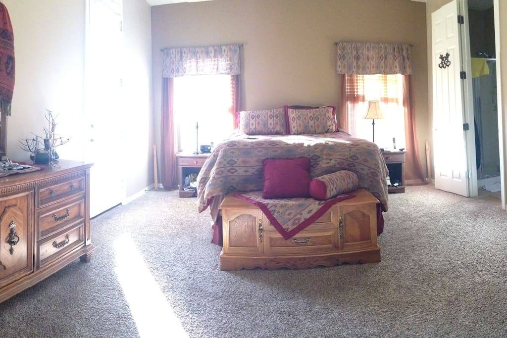 Spacious master bed with queen pillow top bed and access to cozy, private back patio (door on left)