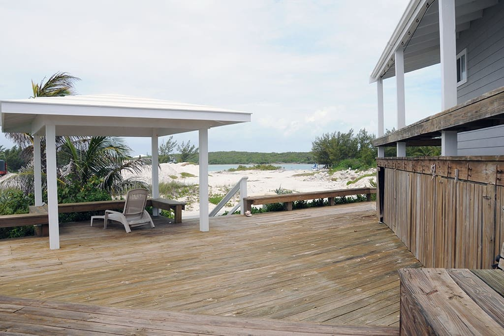 Deck with gazebo and dock across the road in background.