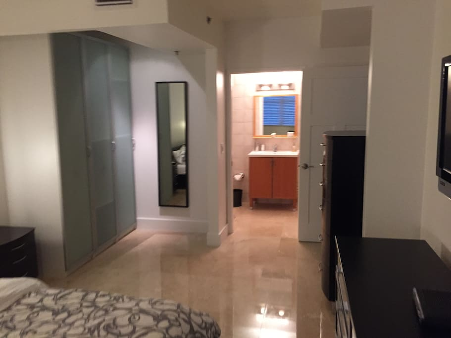 Master bedroom with bathroom with shower/tub