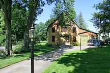 Guests may relax in a lovely, quiet garden with dappled afternoon shade and a view of the carriage house.
