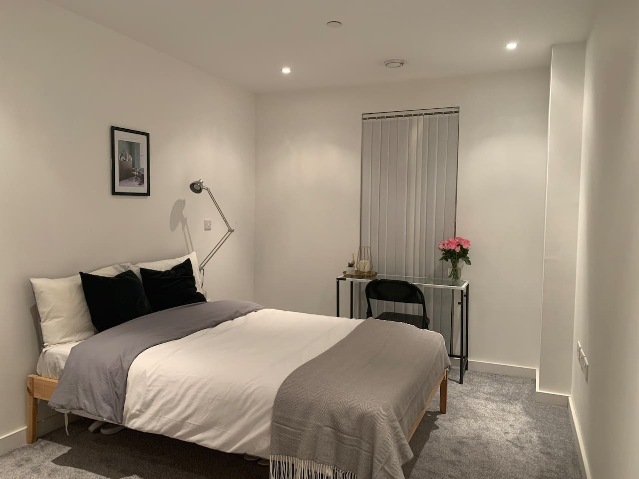 Beautifully minimalistic, stylish and clean room, complete with built in wardrobe and city view.