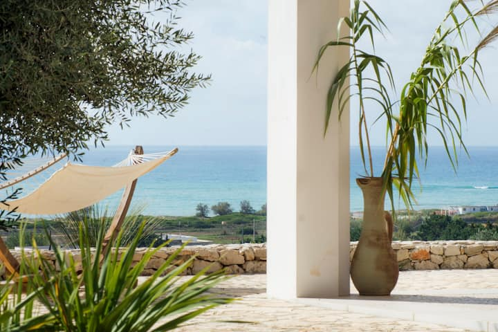 Villa with sea view in mediterranean garden