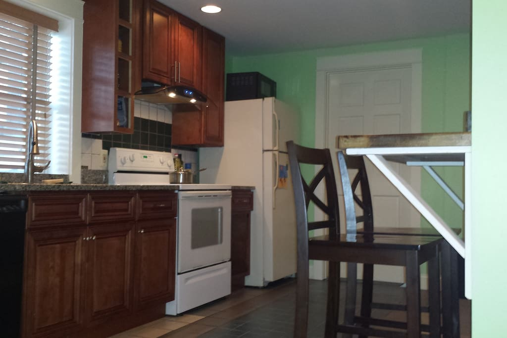 Review of the kitchen as you enter the basement studio.