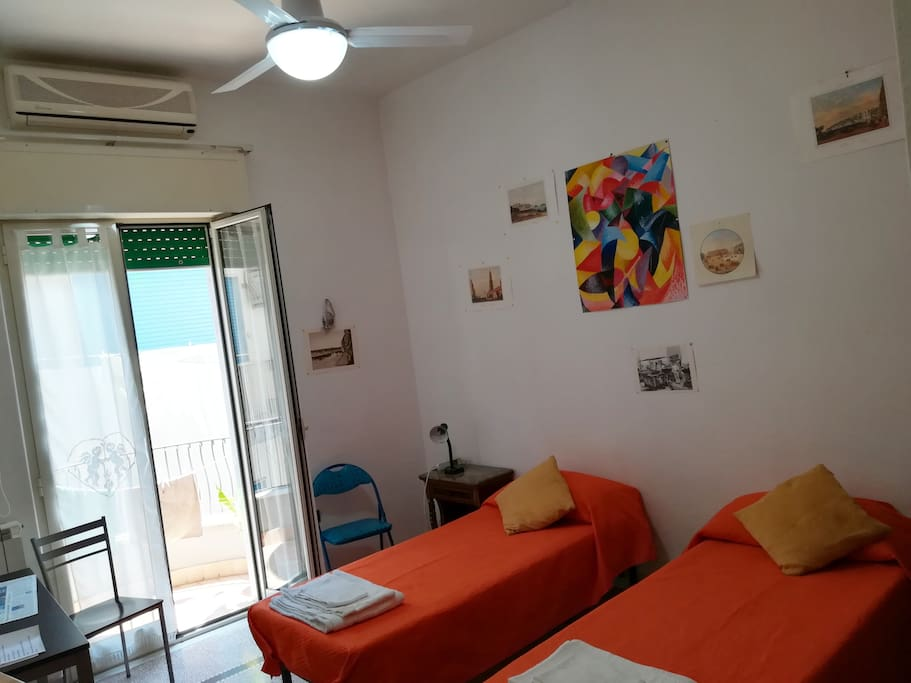 The second bedroom with a bright balcony on the Spanish Naples (Ceiling fan)