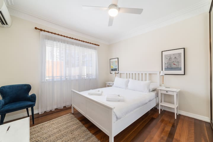 The master bedroom has a queen bed, air-conditioning, wardrobe space and luxury cotton linens for a good night's sleep.
