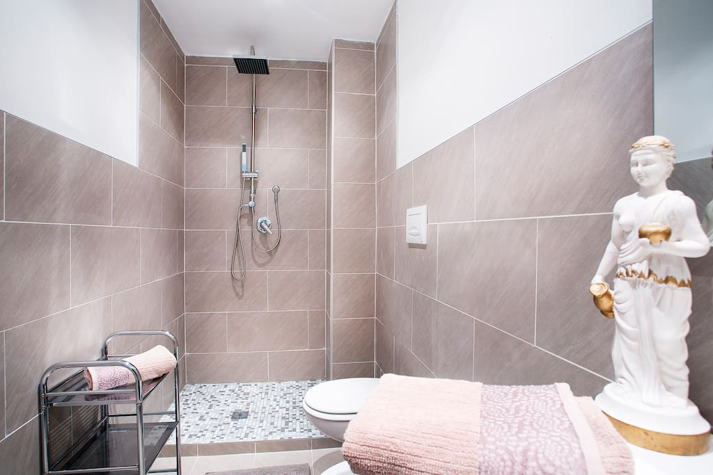Two bathrooms featuring shower and wc in each
