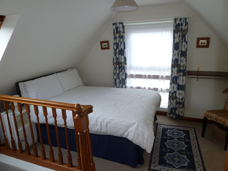 Double bedroom at top of stairs leading to twin room.