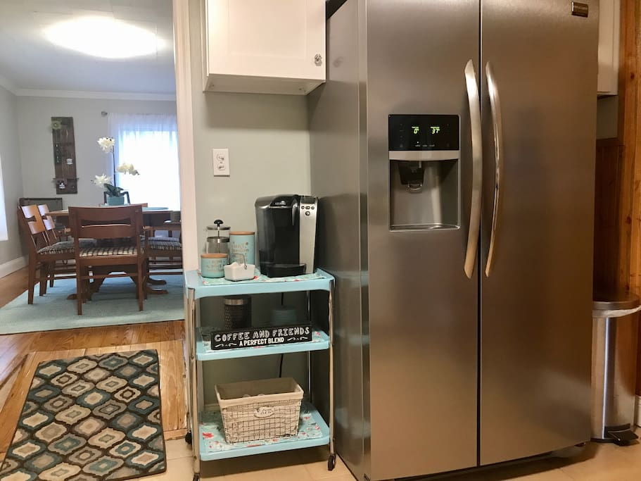 A brand new refrigerator with water and ice in the door. Complimentary condiments to share to make meals a little easier.