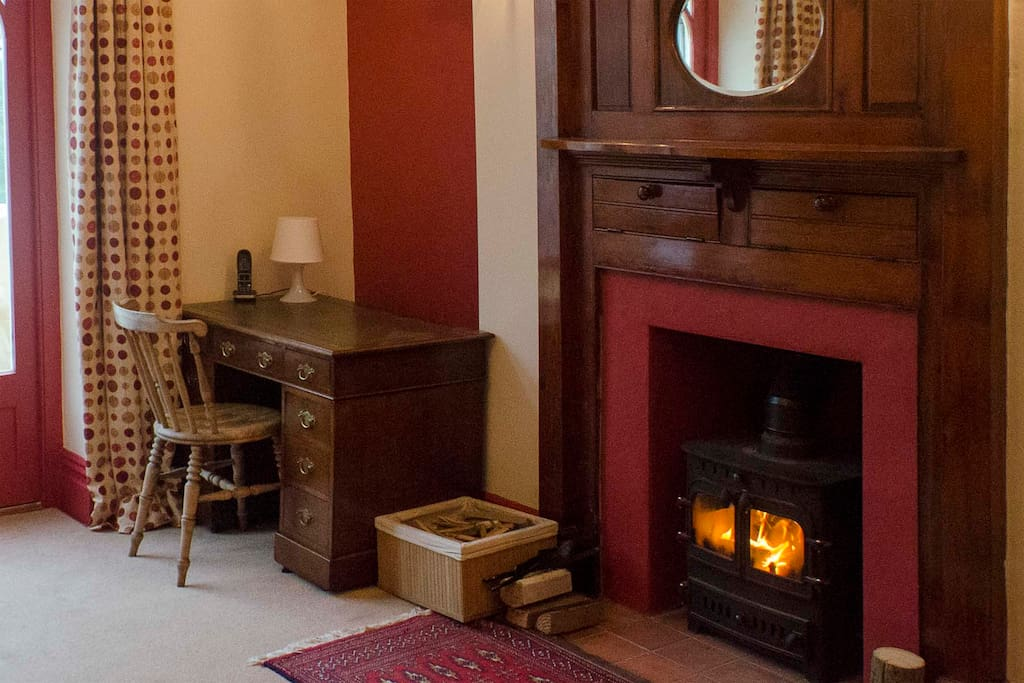 The cosy guest lounge with wood burning stove