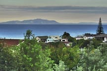 View over Omaha Bay from backyard. Coromandel in distance.