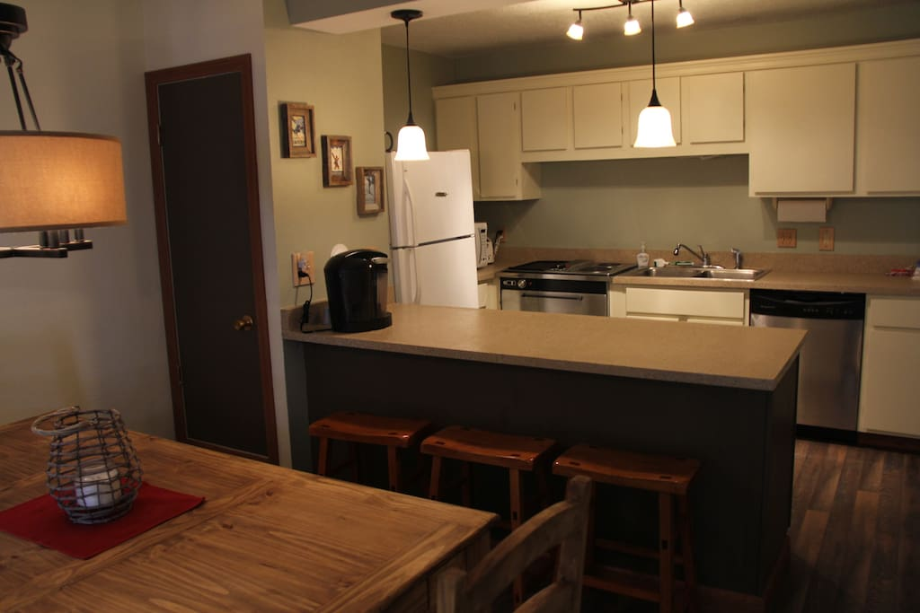 Fully equipped kitchen, large dining area, and breakfast bar.