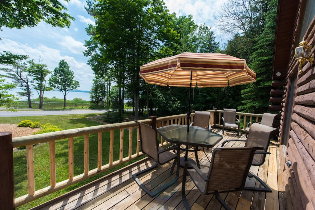 Long front deck with patio seating and 180 degree view of the Bay.