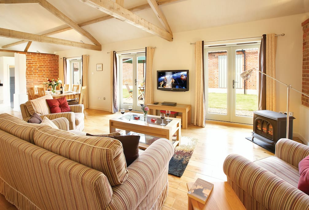 Ground floor:  Open plan sitting room with French doors opening out onto the garden
