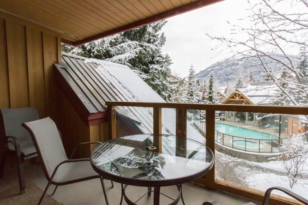 Balcony overlooking outdoor heated swimming pool