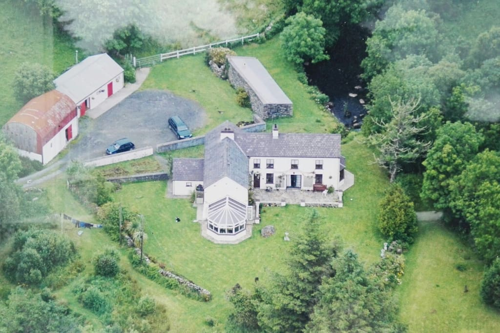 Aerial view of house,garden and river to enjoy