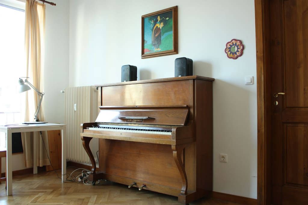 piano with professional audio monitors (speakers)