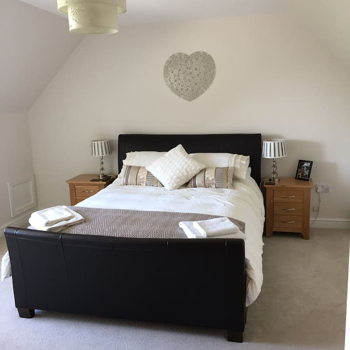 Spacious double ensuite bedroom with king size bed