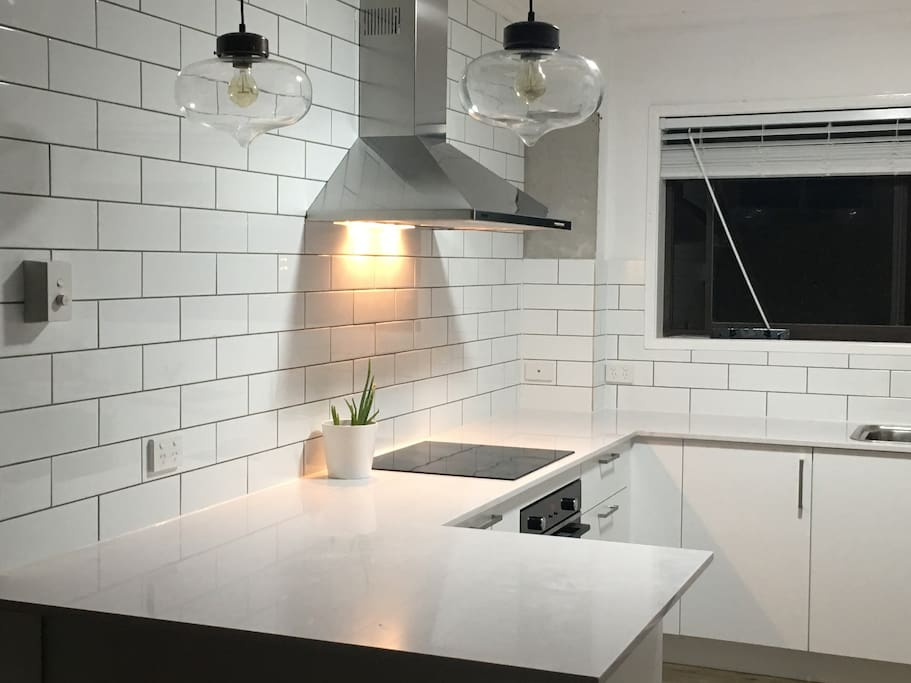 Newly renovated kitchen with new appliances.