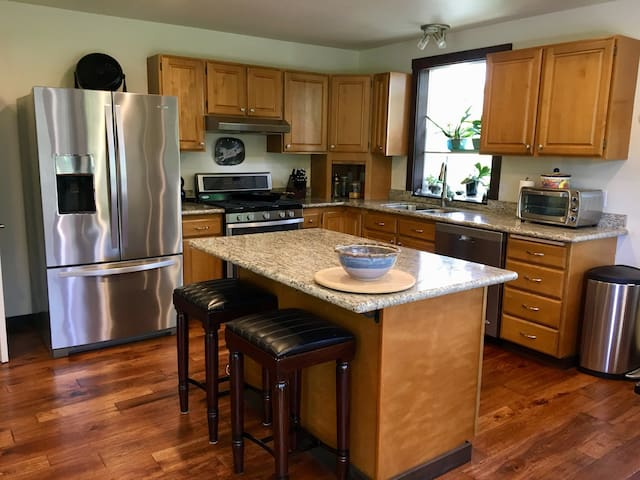 Upgraded kitchen with stainless appliances and granite countertops