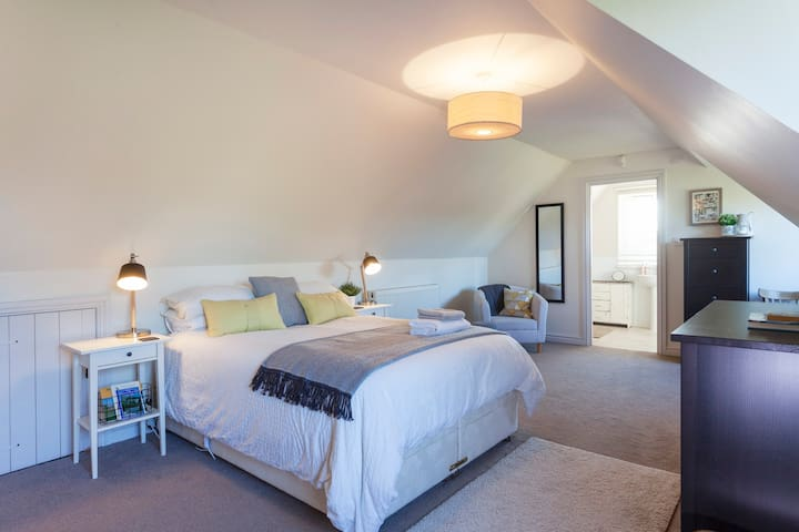 Large, spacious, sunny bedroom with sitting area, a perfect spot for a morning coffee.