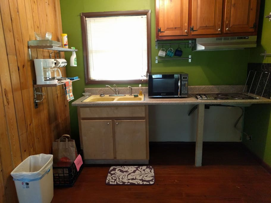 Fully functioning Kitchen with stove top, microwave, full-sized fridge, all the utensils and dishes you need to cook, and Coffee!