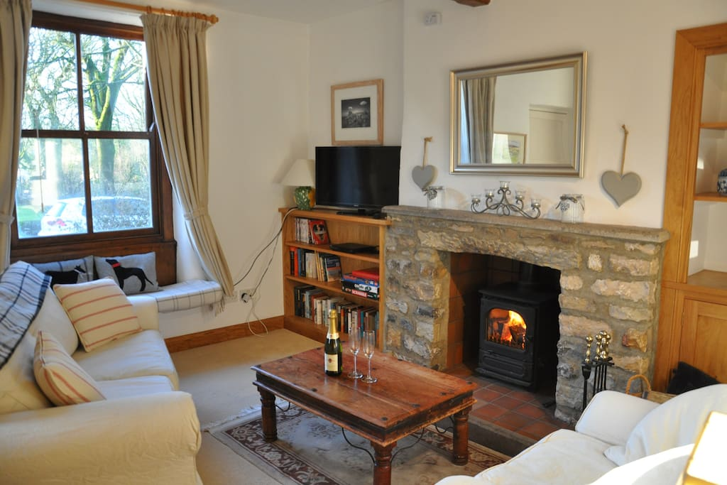 Beamed sitting room with log burning stove