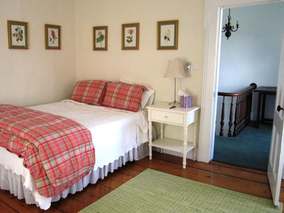 Bedrooms with queen beds, wide plank floors and lots of light.