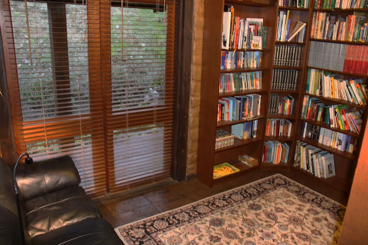 Shared Library **Two additional single beds can be added to this private room. A huge collection of books, media and games for all the family to enjoy.