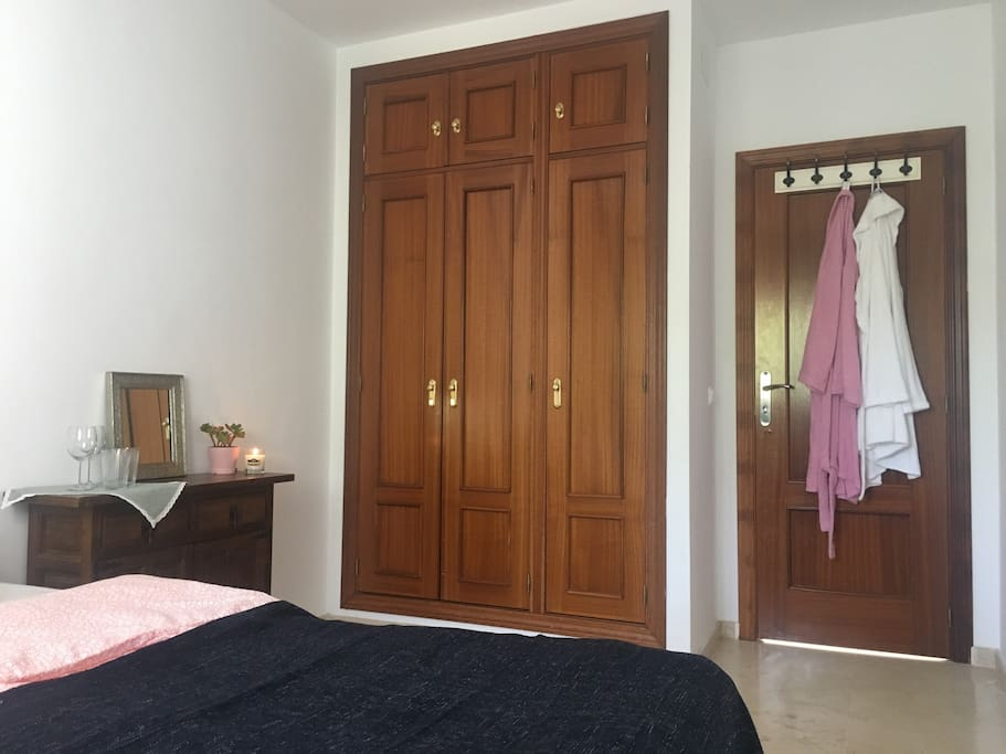 Bedroom with private bathroom outside in hallway. Bath robes are included.