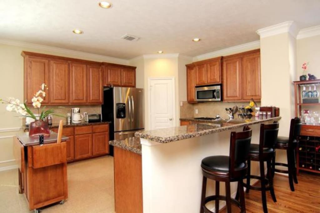 Spacious and functional kitchen space, fully equipped and stocked with lots of nice white china and stem/glassware