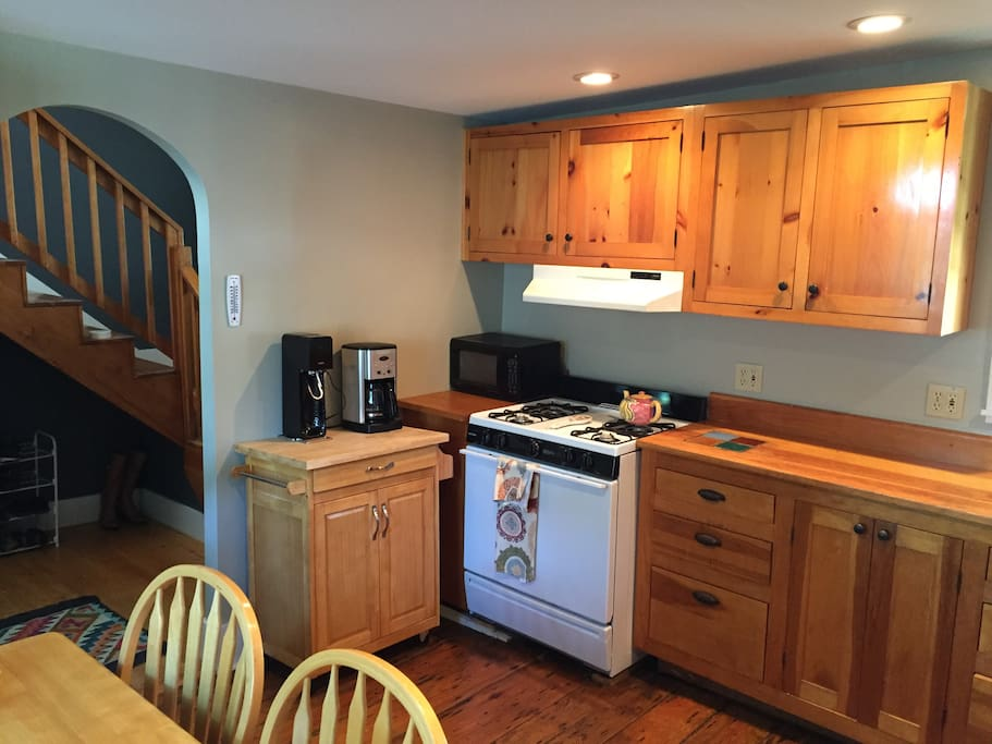 Charming first floor kitchen with amazing natural light from bay window with stained glass